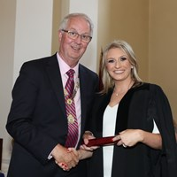 President Michael Quinlan with Christine Simpson of Matheson